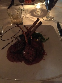 Lamb chops served with a Saffron Risotto cake, broccoli rabe and a creamy peppercorn sauc